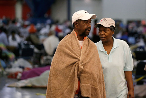 "<div class=""meta image-caption""><div class=""origin-logo origin-image none""><span>none</span></div><span class=""caption-text"">Ezekiel Lyons, left, walks with his wife at the George R. Brown Convention Center that has been set up as a shelter on Tuesday, Aug. 29, 2017. (LM Otero/AP Photo)</span></div>"