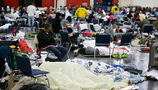 "<div class=""meta image-caption""><div class=""origin-logo origin-image none""><span>none</span></div><span class=""caption-text"">People rest at the George R. Brown Convention Center that has been set up as a shelter on Tuesday, Aug. 29, 2017. (LM Otero/AP Photo)</span></div>"