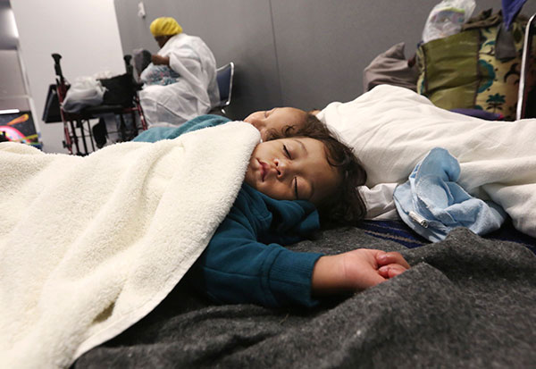 <div class='meta'><div class='origin-logo' data-origin='none'></div><span class='caption-text' data-credit='LM Otero/AP Photo'>Robert Salgado, 2, sleeps on the floor at the George R. Brown Convention Center that has been set up as a shelter on Tuesday, Aug. 29, 2017.</span></div>
