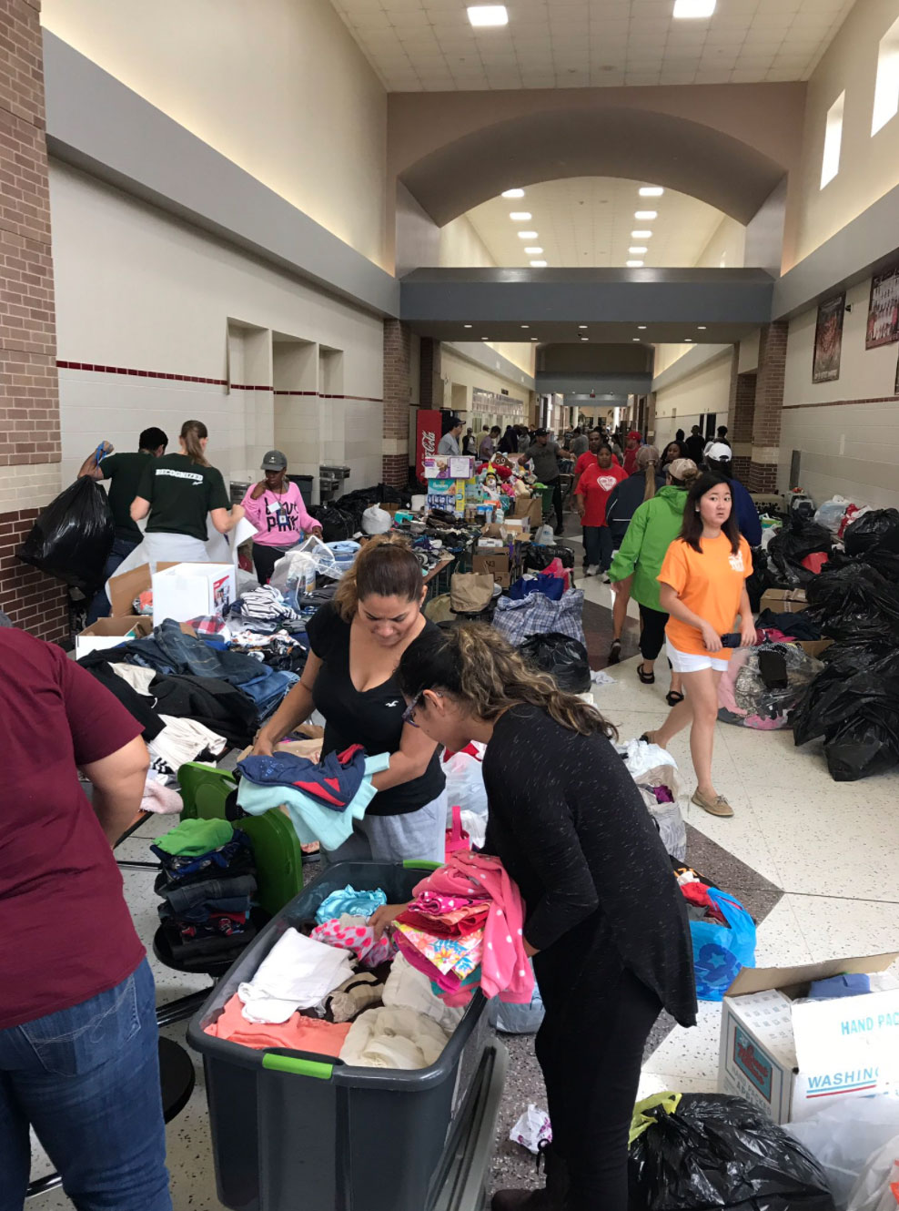"<div class=""meta image-caption""><div class=""origin-logo origin-image none""><span>none</span></div><span class=""caption-text"">People take shelter at Alief Taylor High School. (AliefISD/Twitter)</span></div>"