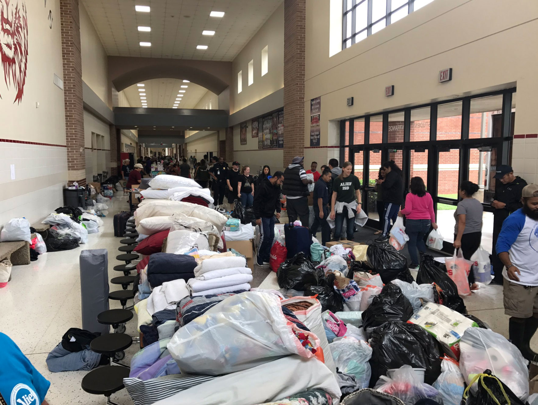 <div class='meta'><div class='origin-logo' data-origin='none'></div><span class='caption-text' data-credit='AliefISD/Twitter'>People take shelter at Alief Taylor High School.</span></div>