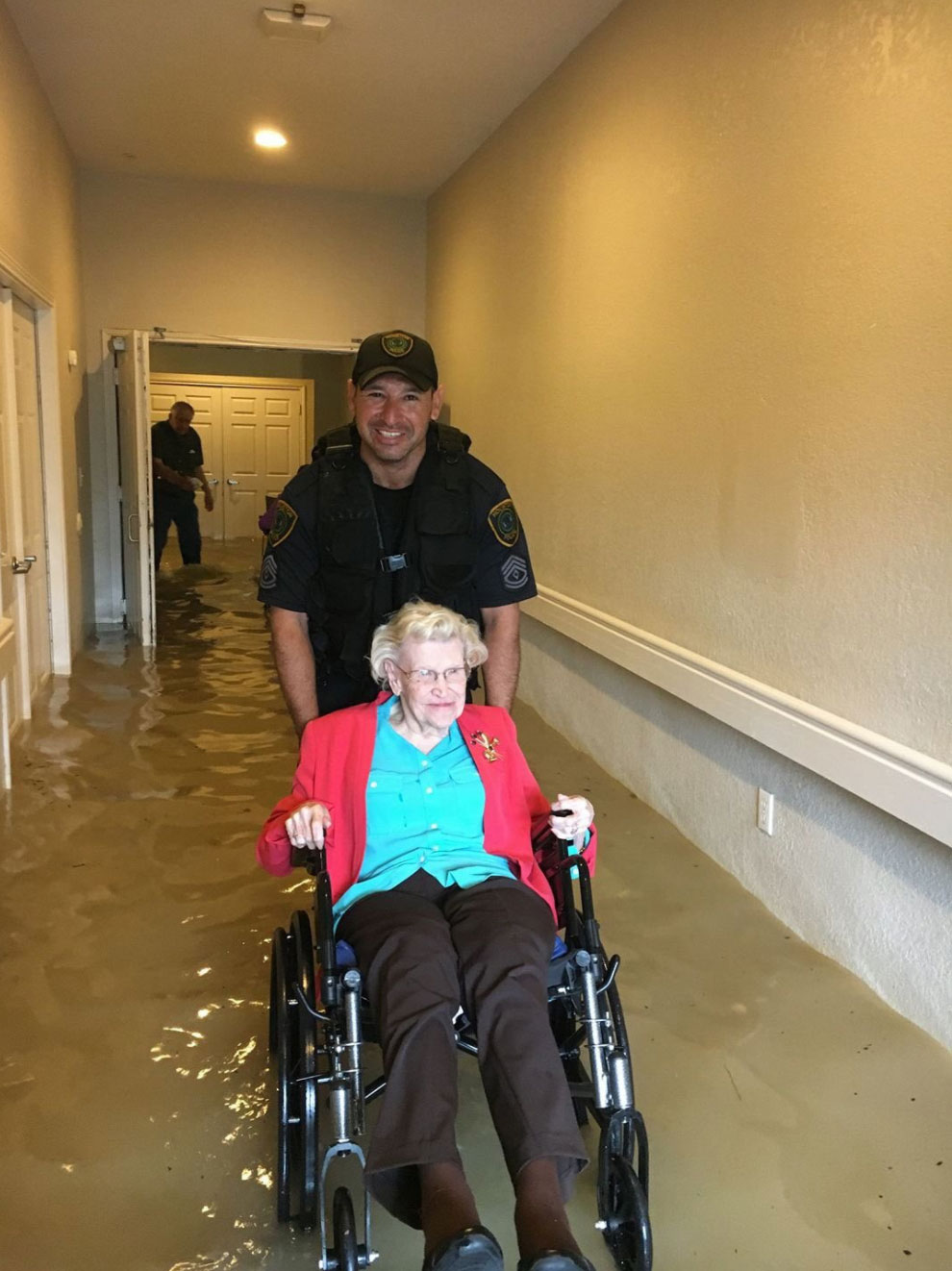 <div class='meta'><div class='origin-logo' data-origin='none'></div><span class='caption-text' data-credit='houstonpolice/Twitter'>The Houston Police rescues a woman stranded by the flood.</span></div>
