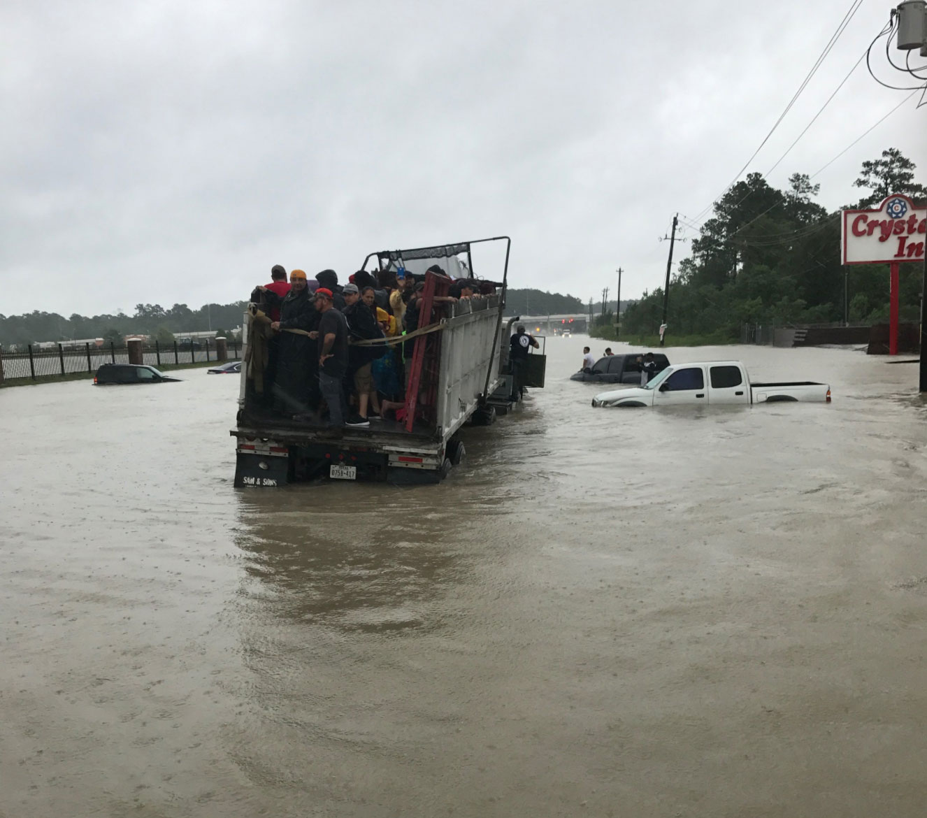 "<div class=""meta image-caption""><div class=""origin-logo origin-image none""><span>none</span></div><span class=""caption-text"">The Harris County Sheriff posted this photo of residents rescued in a convoy while helping out with rescues on Tidwell Rd in Houston. (SheriffEd_HCSO/Twitter)</span></div>"