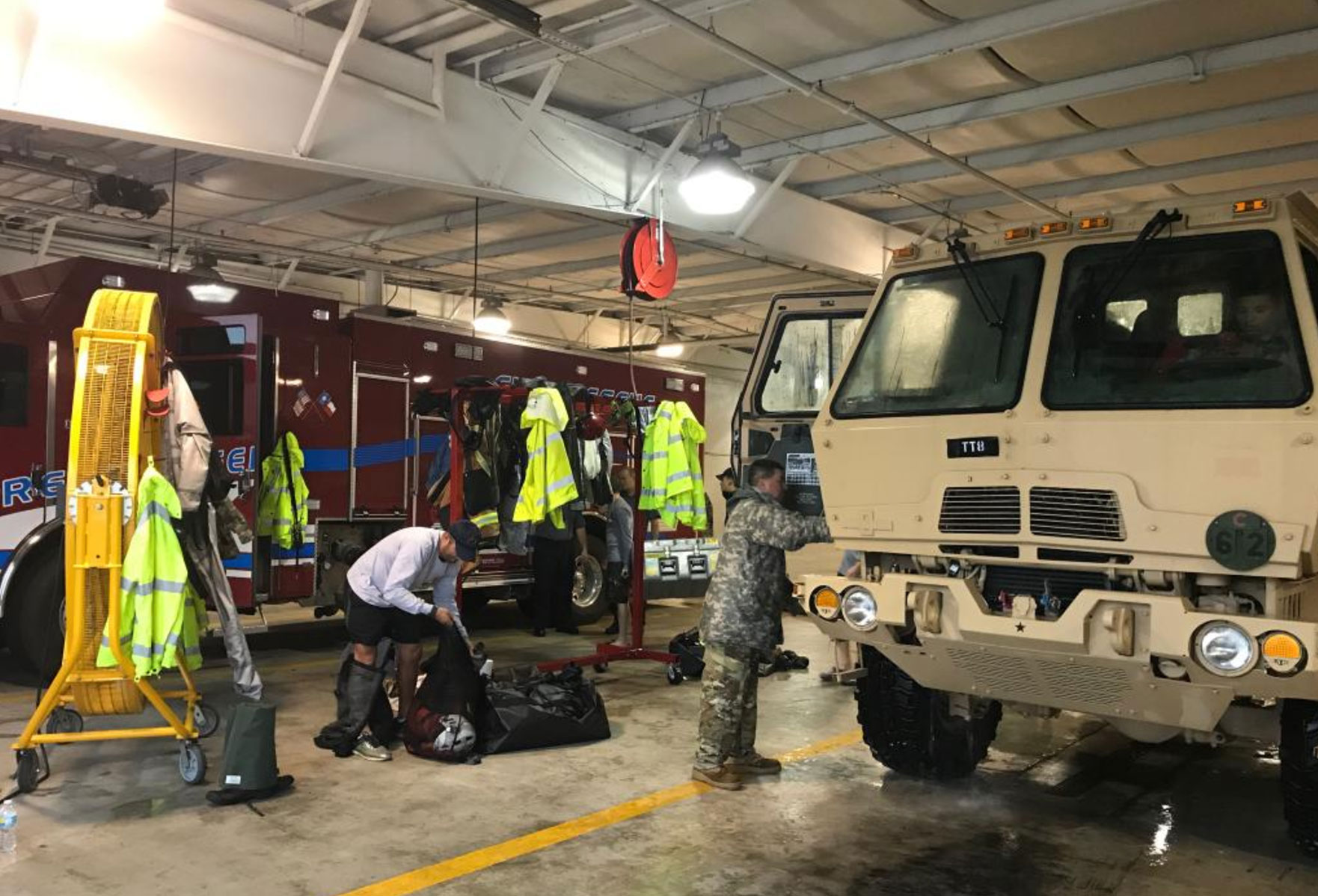 <div class='meta'><div class='origin-logo' data-origin='none'></div><span class='caption-text' data-credit='TXMilitary/Twitter'>''#PhotosFromtheField: One team, one mission. #TMDHarvey #Harvey,'' the Texas Military Department posted on Twitter.</span></div>