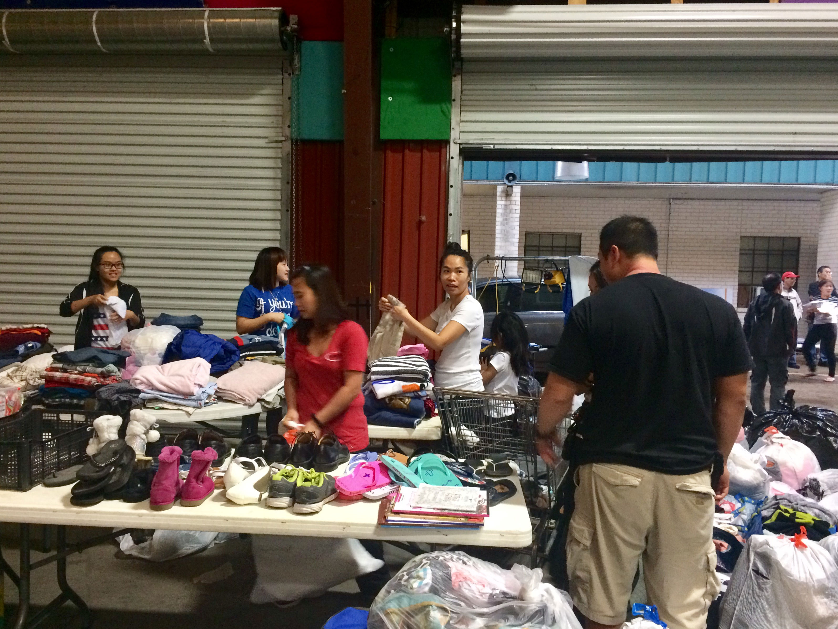 "<div class=""meta image-caption""><div class=""origin-logo origin-image none""><span>none</span></div><span class=""caption-text"">Volunteers sort through donations in this viewer-submitted photo. (Uyen Do)</span></div>"