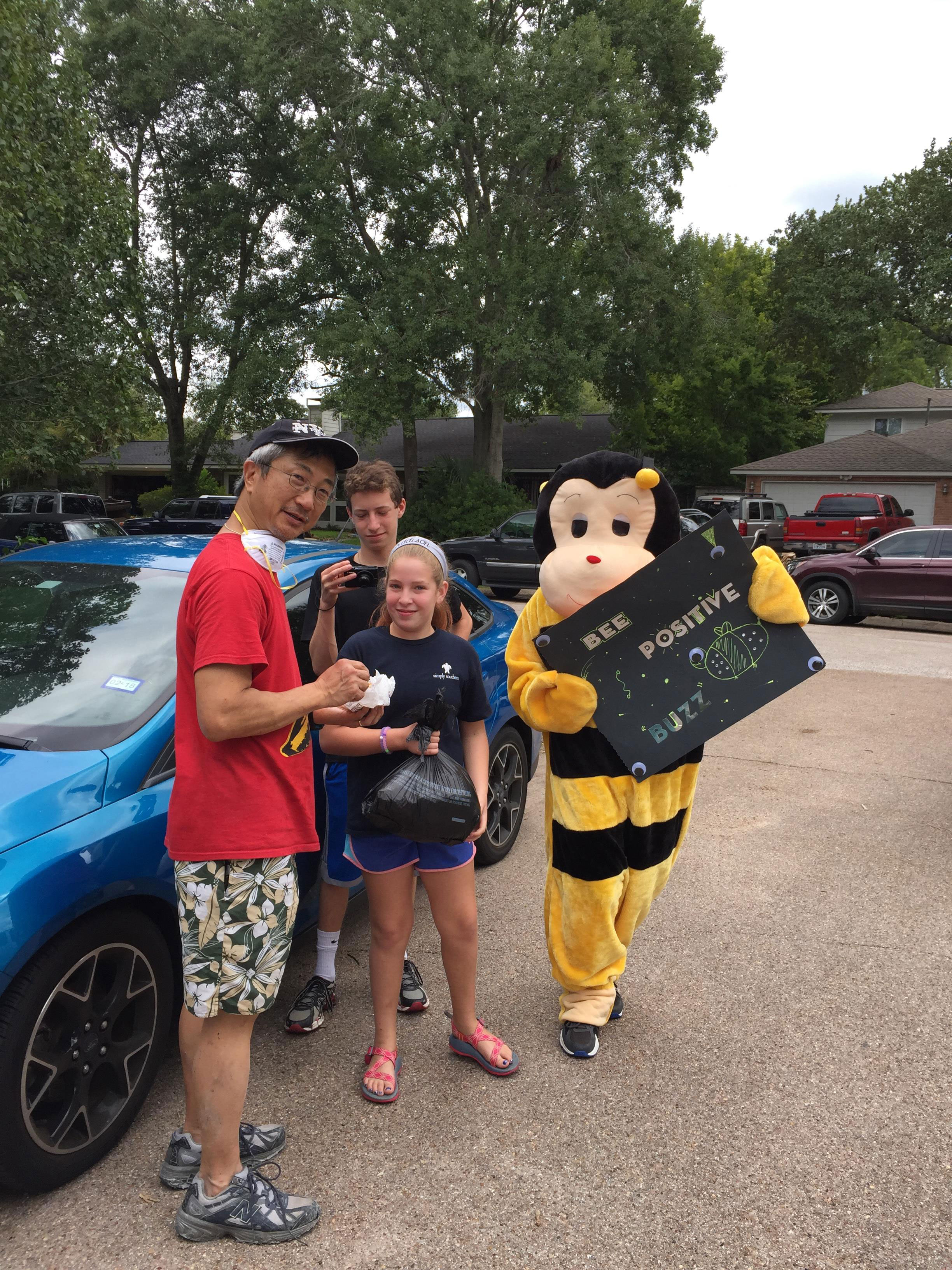 <div class='meta'><div class='origin-logo' data-origin='none'></div><span class='caption-text' data-credit='Stephanie Ochoa'>A person dressed as a bee in the Willow Meadows subdivision was handing out free food with a message: ''Bee positive.''</span></div>