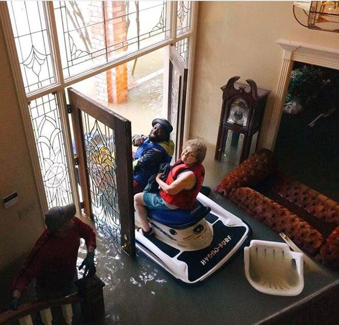 <div class='meta'><div class='origin-logo' data-origin='none'></div><span class='caption-text' data-credit='Karen and J.C. Spencer'>Karen Spencer, a great-grandmother, told ABC she was thinking ''I can't believe I'm leaving my flooded house in a Jet Ski'' when this photo was taken.</span></div>