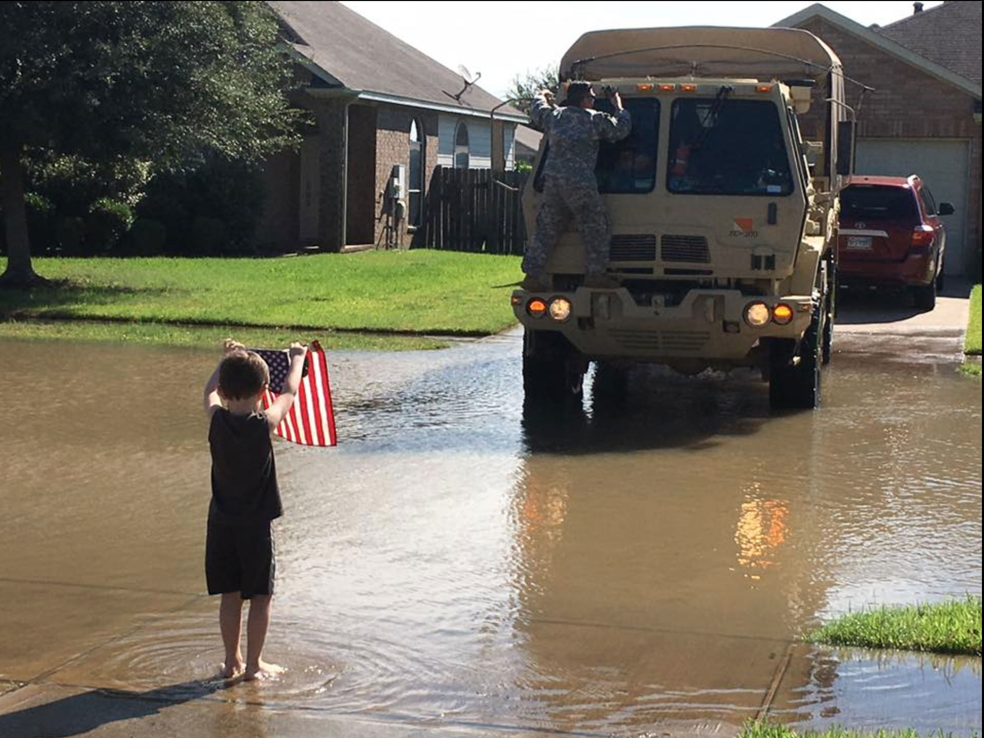 <div class='meta'><div class='origin-logo' data-origin='none'></div><span class='caption-text' data-credit='Emily Fearno Claburn/Facebook'>Little JW Claburn welcomed the National Guard into his community, Rio Vista, with an American flag. JW will turn 5 on Sept. 6.</span></div>