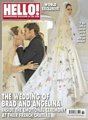 "<div class=""meta ""><span class=""caption-text "">The back of the dress--which has artwork by the children sewn into it--is featured on the cover of Hello! Magazine. (Hello! Magazine)</span></div>"