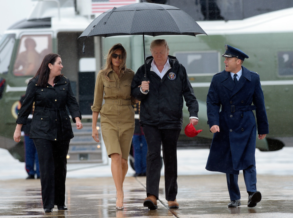 <div class='meta'><div class='origin-logo' data-origin='none'></div><span class='caption-text' data-credit='Susan Walsh/AP Photo'>President Donald Trump and first lady Melania Trump walk towards Air Force One at Andrews Air Force Base in Md.</span></div>