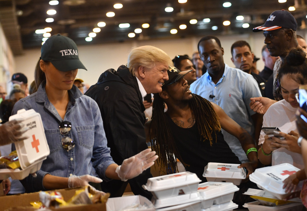 <div class='meta'><div class='origin-logo' data-origin='none'></div><span class='caption-text' data-credit='NICHOLAS KAMM/AFP/Getty Images'>President Donald Trump and First Lady Melania Trump serve food to Hurricane Harvey victims at NRG Center in Houston on September 2, 2017.</span></div>
