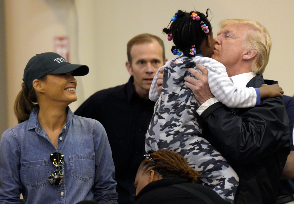 <div class='meta'><div class='origin-logo' data-origin='none'></div><span class='caption-text' data-credit='Susan Walsh/AP Photo'>President Donald Trump and Melania Trump meet people impacted by Hurricane Harvey during a visit to the NRG Center in Houston, Saturday, Sept. 2, 2017.</span></div>