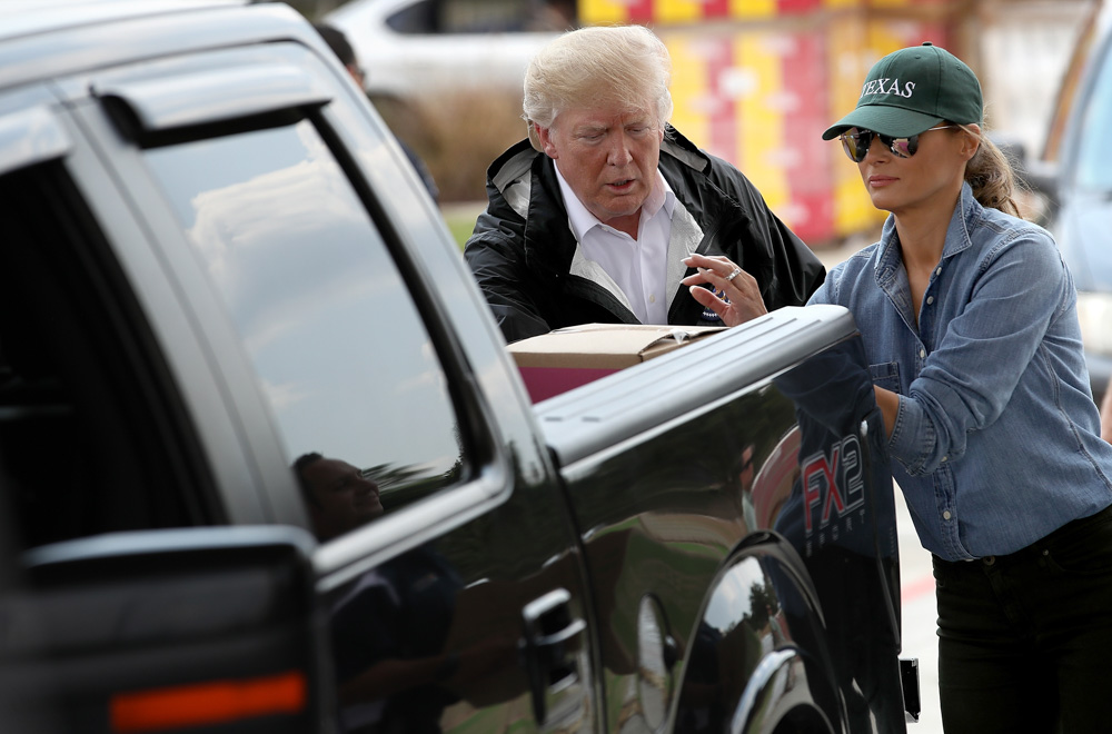 <div class='meta'><div class='origin-logo' data-origin='none'></div><span class='caption-text' data-credit='Win McNamee/Getty Images'>President Donald Trump and first lady Melania Trump hand out emergency supplies to residents impacted by Hurricane Harvey while visiting the First Church of Pearland.</span></div>
