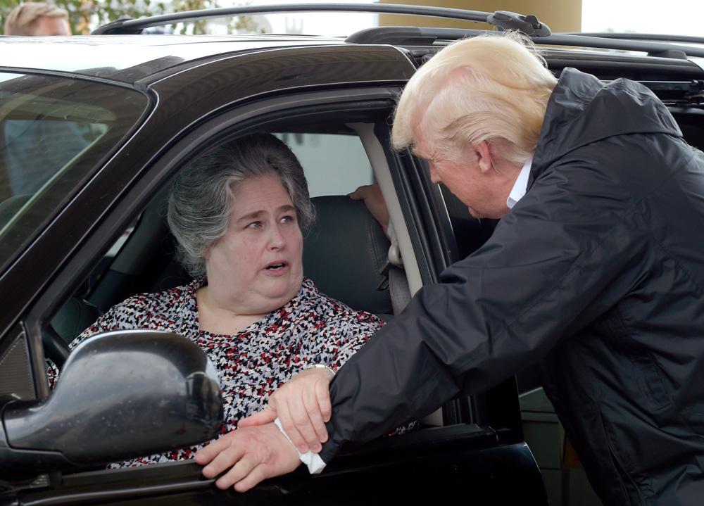 <div class='meta'><div class='origin-logo' data-origin='none'></div><span class='caption-text' data-credit='Susan Walsh/AP Photo'>Trump told drivers outside the First Church in Pearland, &#34;Take care of yourself.&#34; Drivers, in turn, thanked Trump and said they are praying for him.</span></div>
