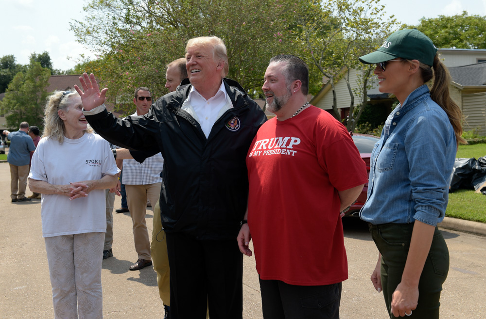 <div class='meta'><div class='origin-logo' data-origin='none'></div><span class='caption-text' data-credit='Susan Walsh/AP Photo'>President Donald Trump and first lady Melania Trump stop to talk with residents impacted by Hurricane Harvey in a Houston neighborhood, Saturday, Sept. 2, 2017.</span></div>