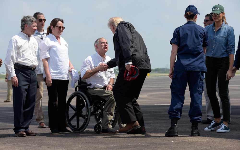 <div class='meta'><div class='origin-logo' data-origin='none'></div><span class='caption-text' data-credit='Susan Walsh/AP Photo'>President Donald Trump shakes hands with Texas Gov. Greg Abbott as he and first lady Melania Trump, right, arrive via Air Force One at Ellington Field in Houston.</span></div>