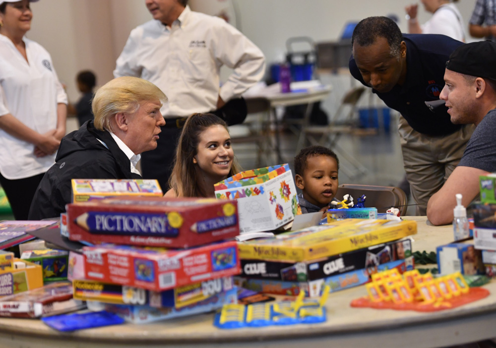 <div class='meta'><div class='origin-logo' data-origin='none'></div><span class='caption-text' data-credit='NICHOLAS KAMM/AFP/Getty Images'>President Donald Trump, with Secretary of Housing and Urban Development Ben Carson (2nd R), visits Hurricane Harvey victims at NRG Center in Houston on September 2, 2017.</span></div>