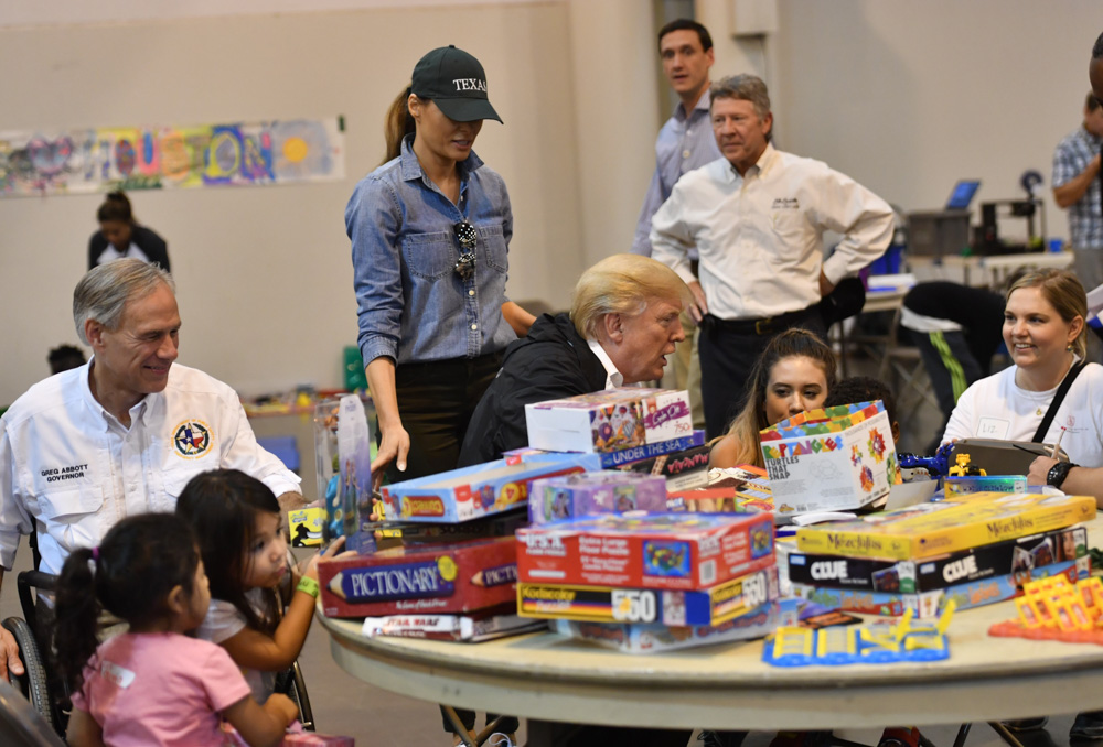 <div class='meta'><div class='origin-logo' data-origin='none'></div><span class='caption-text' data-credit='NICHOLAS KAMM/AFP/Getty Images'>US President Donald Trump, with Texas  Greg Abbott (L) and US First Lady Melania Trump (2nd L) visits Hurricane Harvey victims at NRG Center in Houston on September 2, 2017.</span></div>