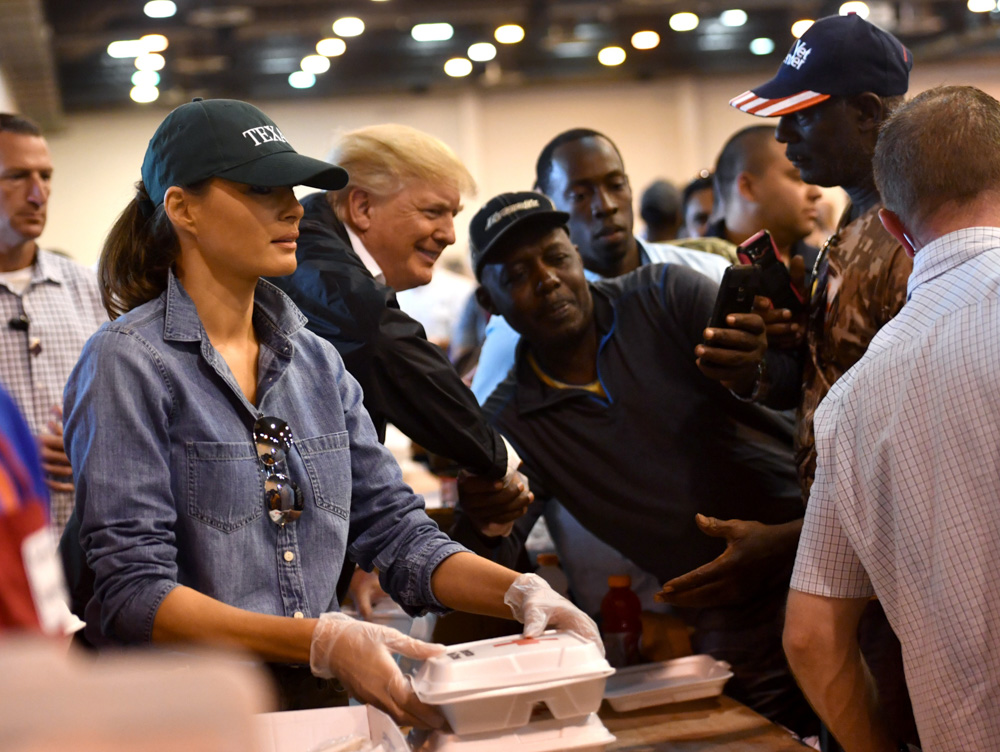 <div class='meta'><div class='origin-logo' data-origin='none'></div><span class='caption-text' data-credit='NICHOLAS KAMM/AFP/Getty Images'>US President Donald Trump and First Lady Melania Trump serve food to Hurricane Harvey victims at NRG Center in Houston on September 2, 2017.</span></div>