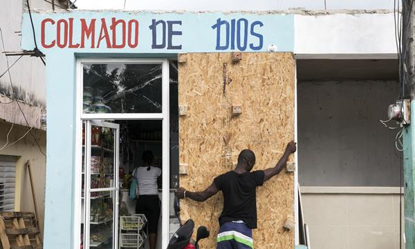 <div class='meta'><div class='origin-logo' data-origin='AP'></div><span class='caption-text' data-credit='Tatiana Fernandez'>A man covers a bodega's windows before the arrival of Hurricane Irma in Las Terrenas, Dominican Republic, Wednesday, Sept. 6, 2017.</span></div>
