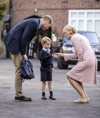 "<div class=""meta image-caption""><div class=""origin-logo origin-image wls""><span>wls</span></div><span class=""caption-text"">Britain's Prince William accompanies Prince George as he is greeted by Helen Haslem - the head of the lower school as he arrives for his first day of school. (Richard Pohle/Pool Photo via AP)</span></div>"