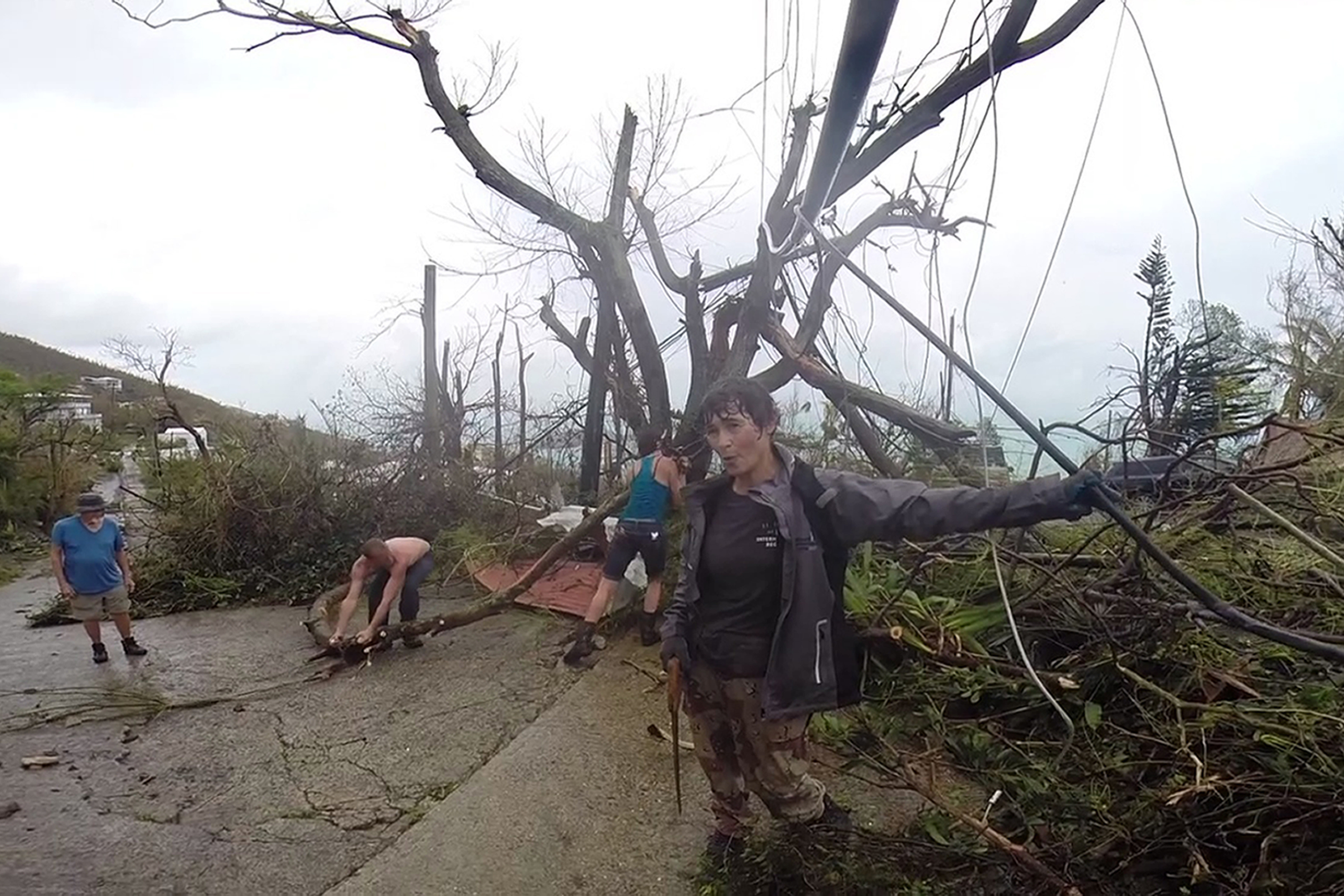 <div class='meta'><div class='origin-logo' data-origin='none'></div><span class='caption-text' data-credit='Ian Brown/AP Photo'>In this image made from video, neighbors clear debris from the road in St. Thomas, U.S. Virgin Islands, Thursday, Sept. 7, 2017.</span></div>