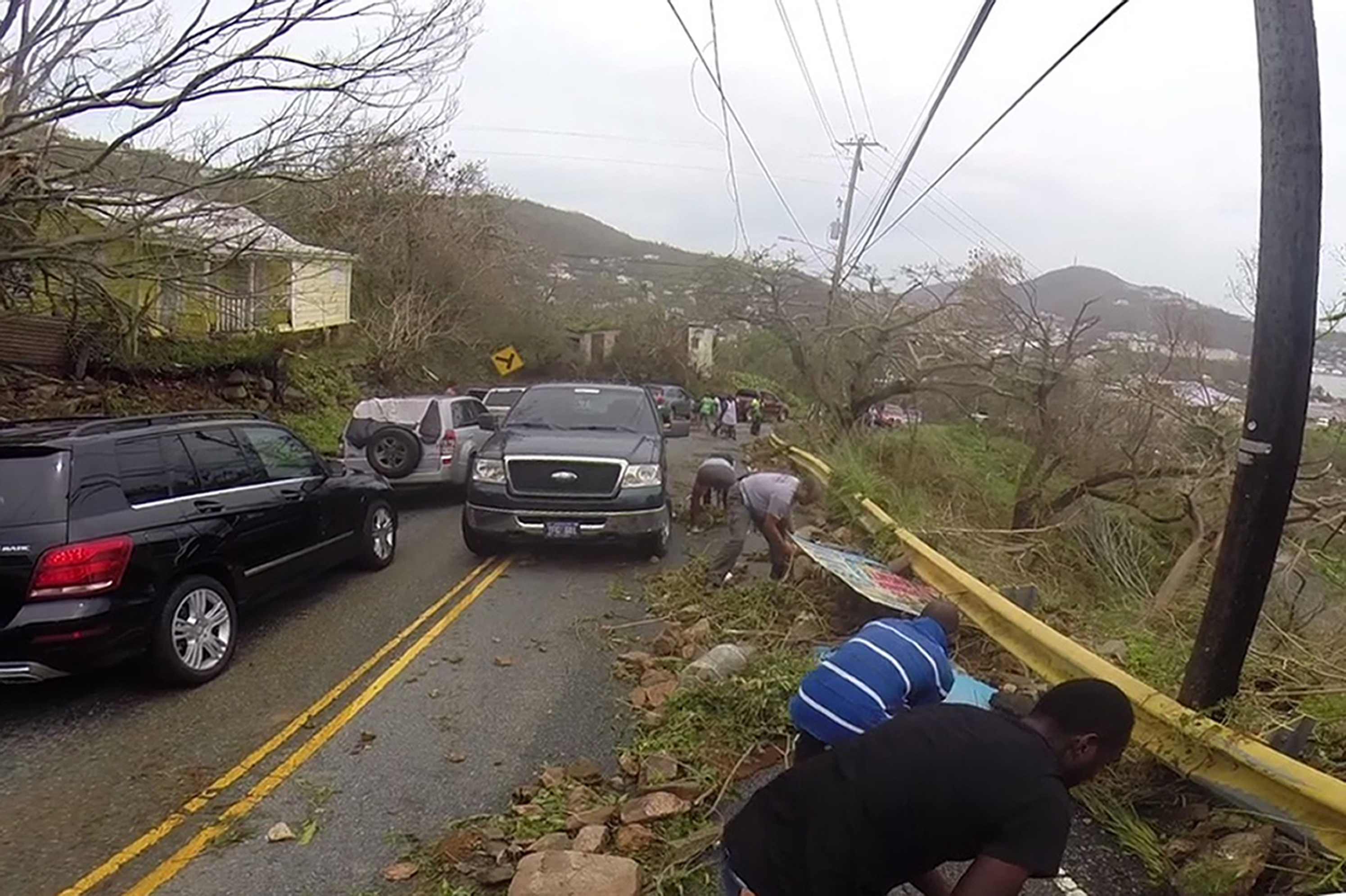 <div class='meta'><div class='origin-logo' data-origin='none'></div><span class='caption-text' data-credit='Ian Brown/AP Photo'>In this image made from video, motorists remove debris caused by Hurricane Irma from the road in St. Thomas, U.S. Virgin Islands, Thursday, Sept. 7, 2017.</span></div>