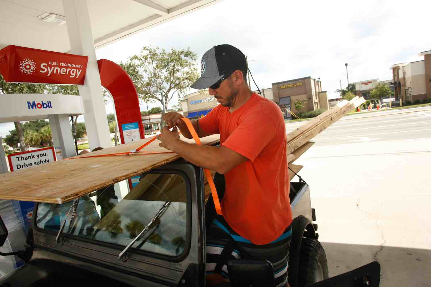 <div class='meta'><div class='origin-logo' data-origin='Creative Content'></div><span class='caption-text' data-credit='Brian Blanco/Getty'>Danny Calvo secures lumber he intends to use to board up his home before evacuating as residents and visitors in Florida prepare for, and evacuate ahead of, Hurricane Irma.</span></div>