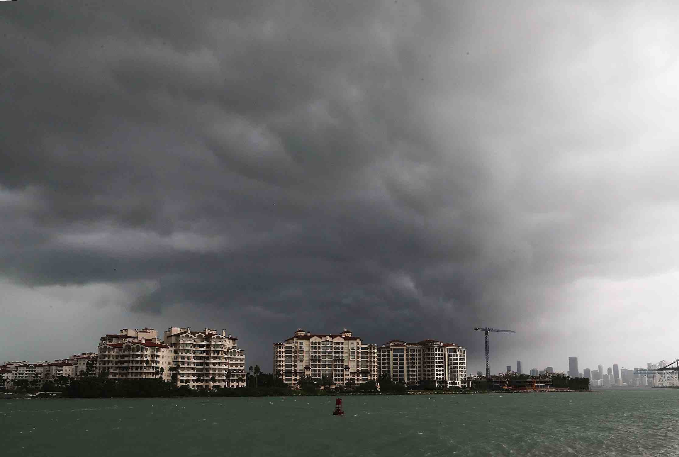 <div class='meta'><div class='origin-logo' data-origin='Creative Content'></div><span class='caption-text' data-credit='Joe Raedle/Getty'>Storm clouds are seen over Fisher Island as Hurricane Irma approaches on September 9, 2017 in Miami Beach, Florida.</span></div>