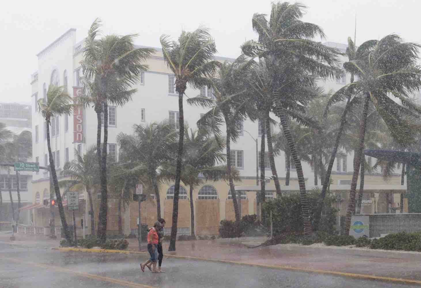 <div class='meta'><div class='origin-logo' data-origin='Creative Content'></div><span class='caption-text' data-credit='SAUL LOEB/AFP/Getty'>People walk down the street as winds and rain begin to hit as outer bands of Hurricane Irma arrive in Miami Beach, Florida, September 9, 2017.</span></div>