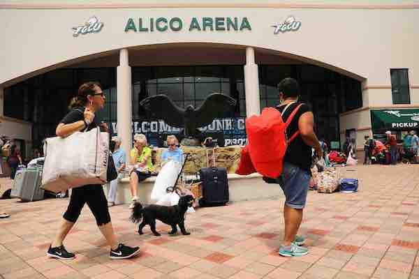 <div class='meta'><div class='origin-logo' data-origin='Creative Content'></div><span class='caption-text' data-credit='Spencer Platt/Getty'>People arrive, many with their animals, a shelter at Alico Arena where thousands of Floridians are hoping to ride out Hurricane Irma on September 9, 2017 in Fort Myers, Florida.</span></div>