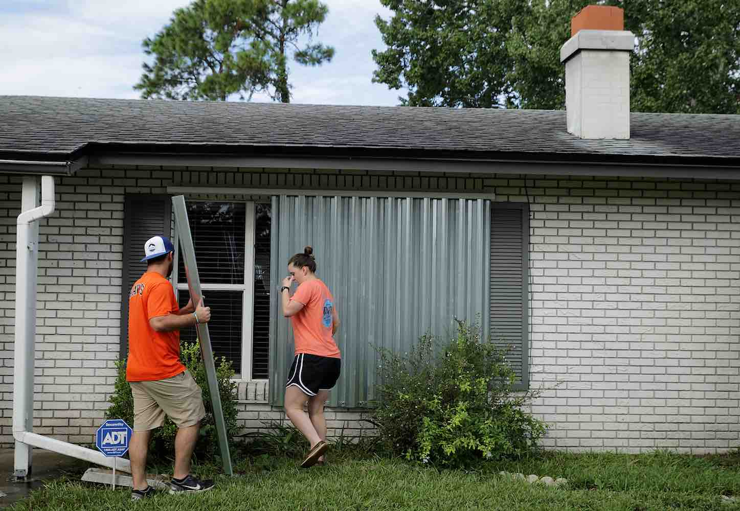 "<div class=""meta image-caption""><div class=""origin-logo origin-image kgo""><span>kgo</span></div><span class=""caption-text"">Caleb Rich and his wife Rachel Rich put metal shutters over windows on their home ahead of the arrival of Hurricane Irma September 9, 2017 in Daytona Beach, Florida.  (Chip Somodevilla/Getty)</span></div>"
