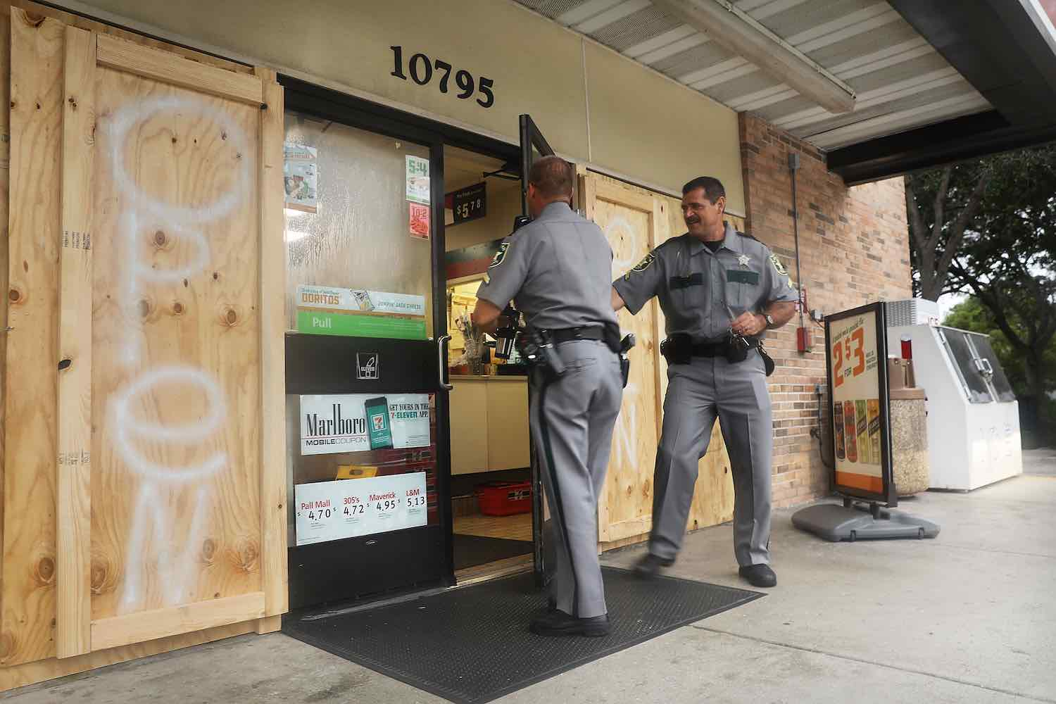 <div class='meta'><div class='origin-logo' data-origin='Creative Content'></div><span class='caption-text' data-credit='Spencer Platt/Getty'>Police enter one the few remaining businesses open in Naples before the arrival of Hurricane Irma into Southwest Florida on September 9, 2017 in Naples, Florida.</span></div>