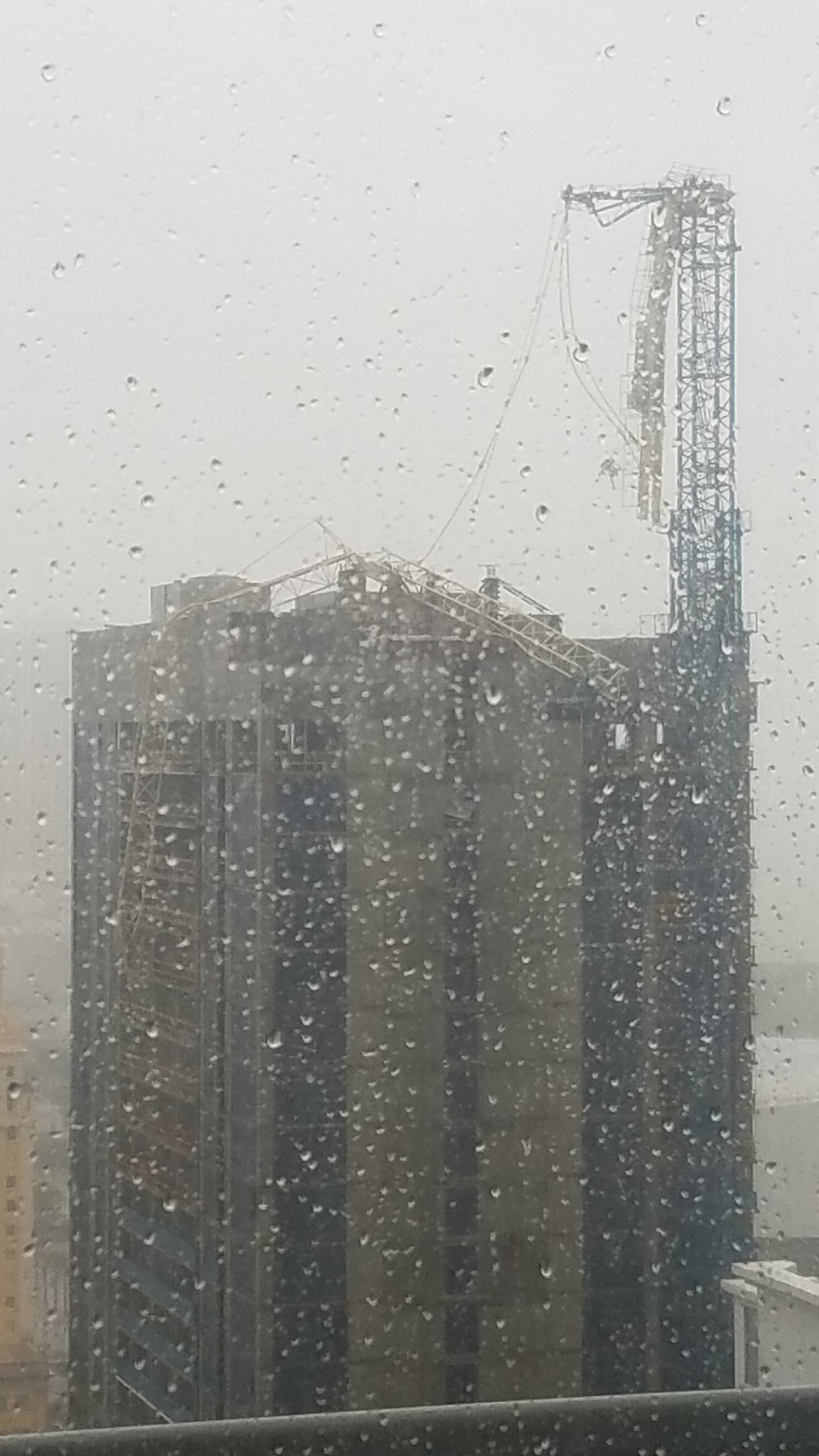 <div class='meta'><div class='origin-logo' data-origin='none'></div><span class='caption-text' data-credit='nesumosa/Twitter'>A large crane snapped from the force of the storm in Miami.</span></div>