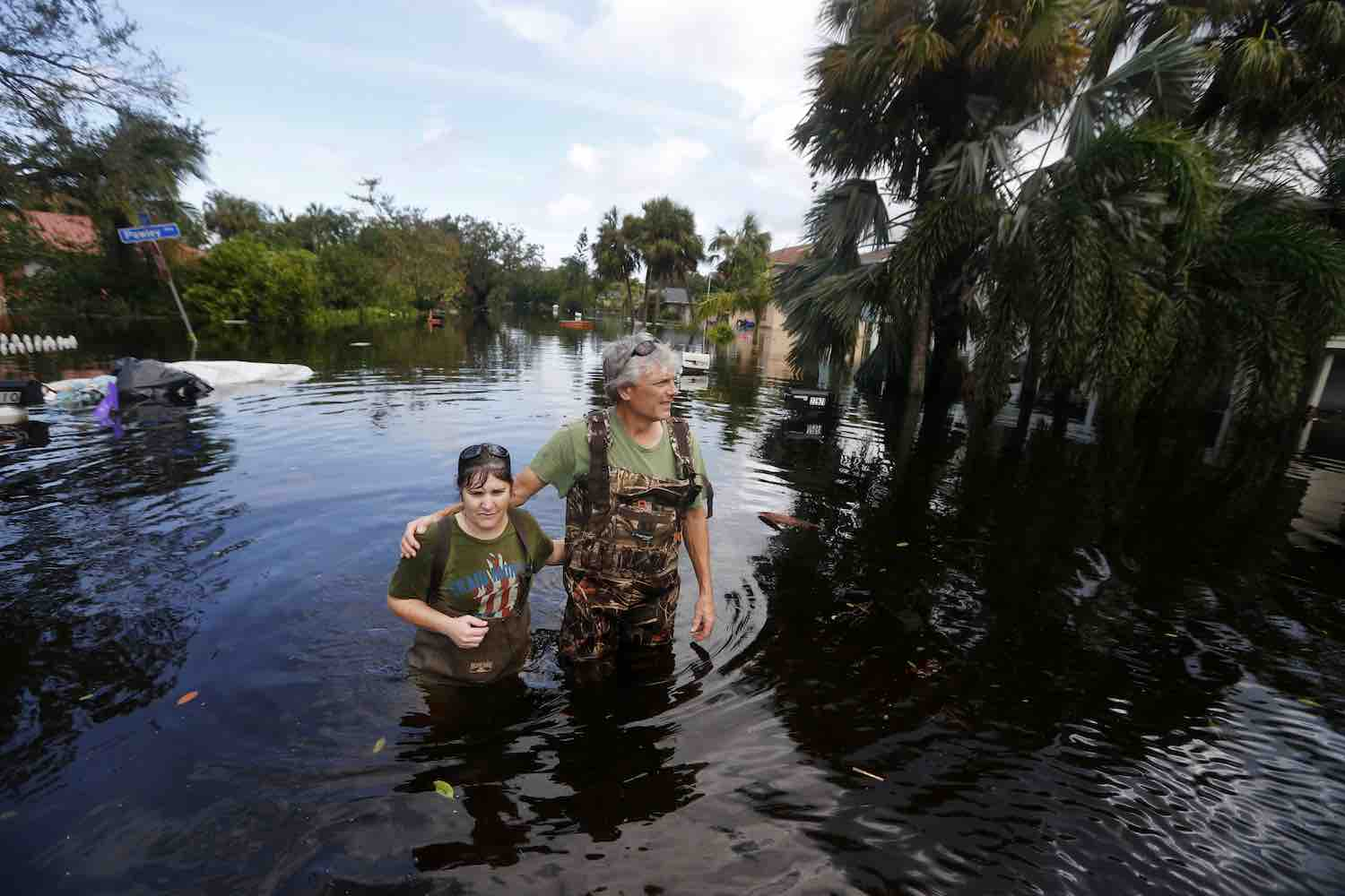 <div class='meta'><div class='origin-logo' data-origin='Creative Content'></div><span class='caption-text' data-credit='AP Photo/Gerald Herbert'>Kelly McClenthen returns to see the flood damage to her home with her boyfriend Daniel Harrison in the aftermath of Hurricane Irma in Bonita Springs, Fla., Monday, Sept. 11, 2017.</span></div>
