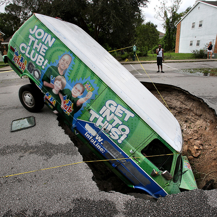 <div class='meta'><div class='origin-logo' data-origin='none'></div><span class='caption-text' data-credit='(Joe Burbank/Orlando Sentinel/TNS via Getty Images'>A van remains in a sinkhole in Winter Springs, Fla., during Hurricane Irma. The glass on the ground (left) is the window that the driver punched out to escape.</span></div>