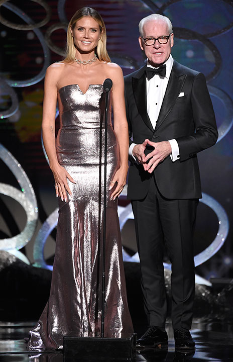 "<div class=""meta image-caption""><div class=""origin-logo origin-image none""><span>none</span></div><span class=""caption-text"">Heidi Klum, left, and Tim Gunn speak during night two of the Television Academy's 2016 Creative Arts Emmy Awards at the Microsoft Theater on Sunday, Sept. 11, 2016 in Los Angeles. (Phil McCarten/Invision for the Television Academy/AP Images)</span></div>"