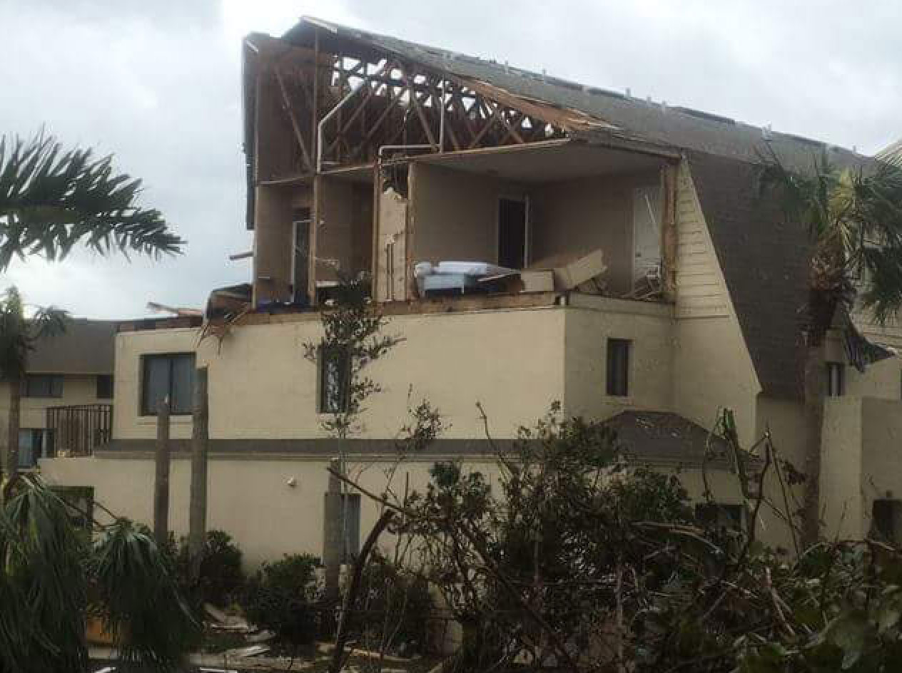"<div class=""meta image-caption""><div class=""origin-logo origin-image none""><span>none</span></div><span class=""caption-text"">Damaged buildings are shown in St. John's after the storm. (St. Johns County Fire Rescue/Facebook)</span></div>"