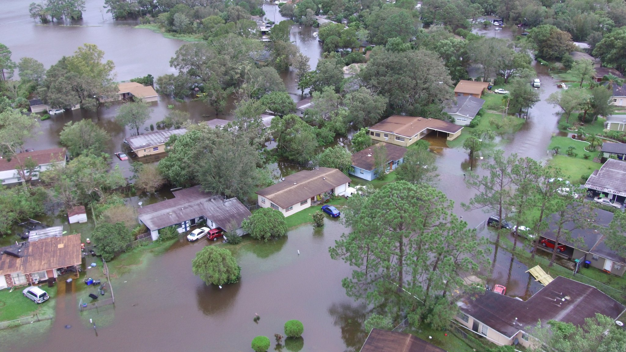 <div class='meta'><div class='origin-logo' data-origin='none'></div><span class='caption-text' data-credit='OCFireRescue/Twitter'>An aerial photo shows flooding in the Orlo Vista area of Orange County.</span></div>