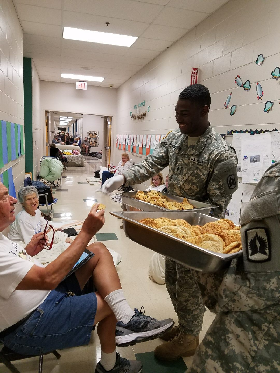 "<div class=""meta image-caption""><div class=""origin-logo origin-image none""><span>none</span></div><span class=""caption-text"">A National Guard soldier sang ''Happy Birthday'' to Shelby Johnson, 80, while passing out cookies. (FLGuard/Twitter)</span></div>"