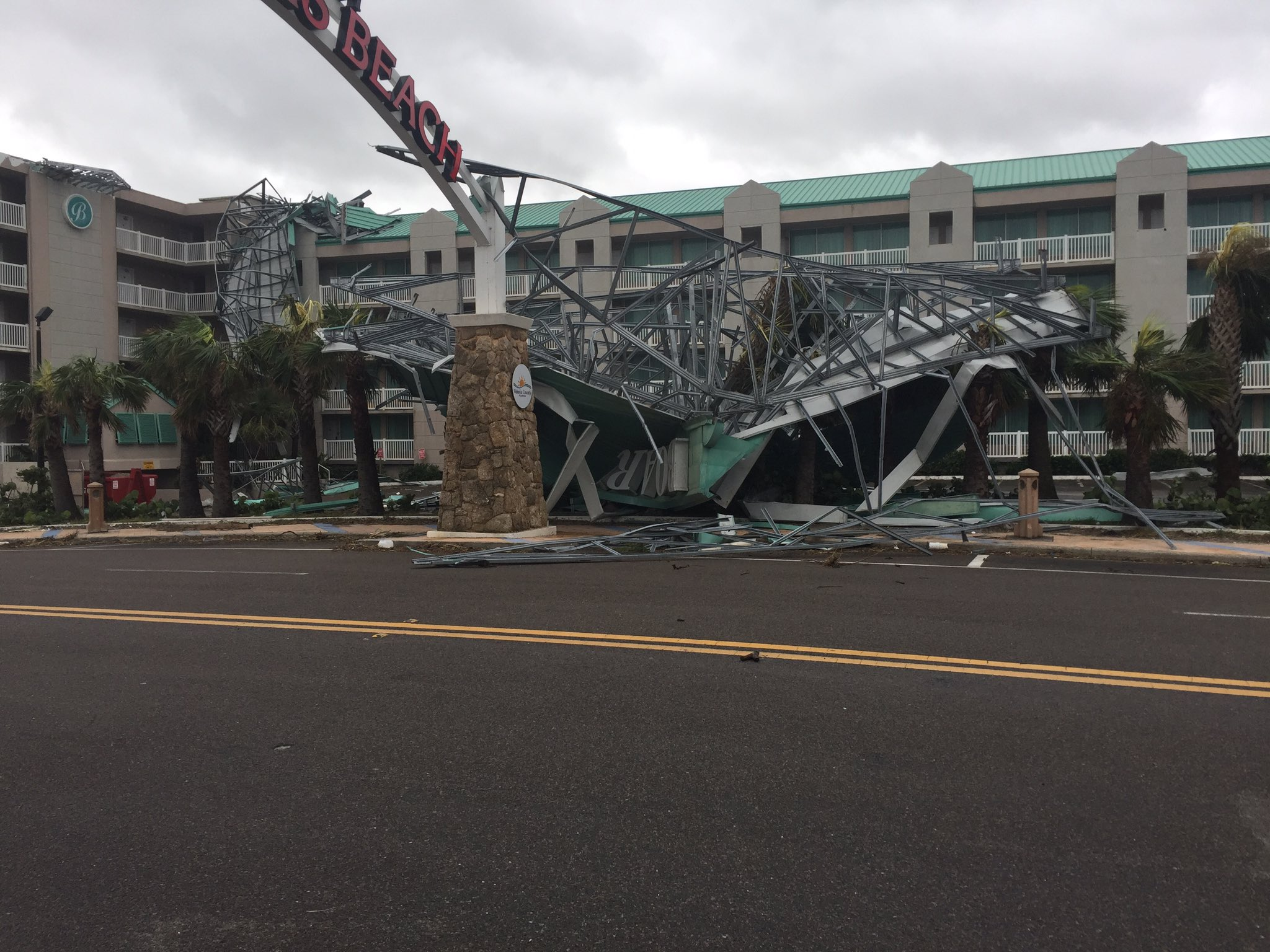"<div class=""meta image-caption""><div class=""origin-logo origin-image none""><span>none</span></div><span class=""caption-text"">Damage is shown near the ''World's Most Famous Beach'' sign in Daytona Beach on Monday. (Ty Russell/Daytona Beach)</span></div>"