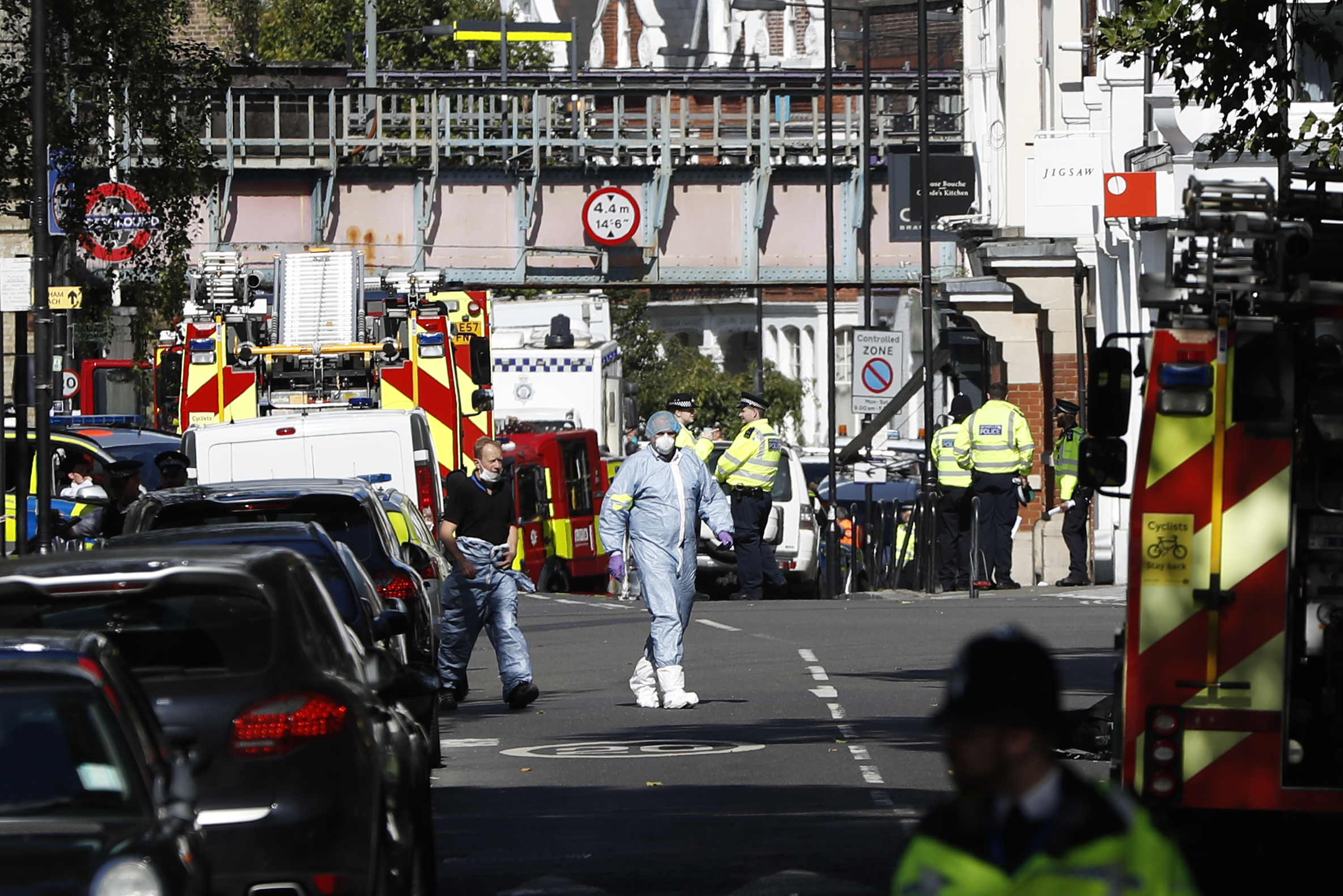 "<div class=""meta image-caption""><div class=""origin-logo origin-image none""><span>none</span></div><span class=""caption-text"">Police forensic officers walk within a cordon near where an incident happened, that police say they are investigating as a terrorist attack, at Parsons Green subway station. (Kirsty Wigglesworth/AP Photo)</span></div>"