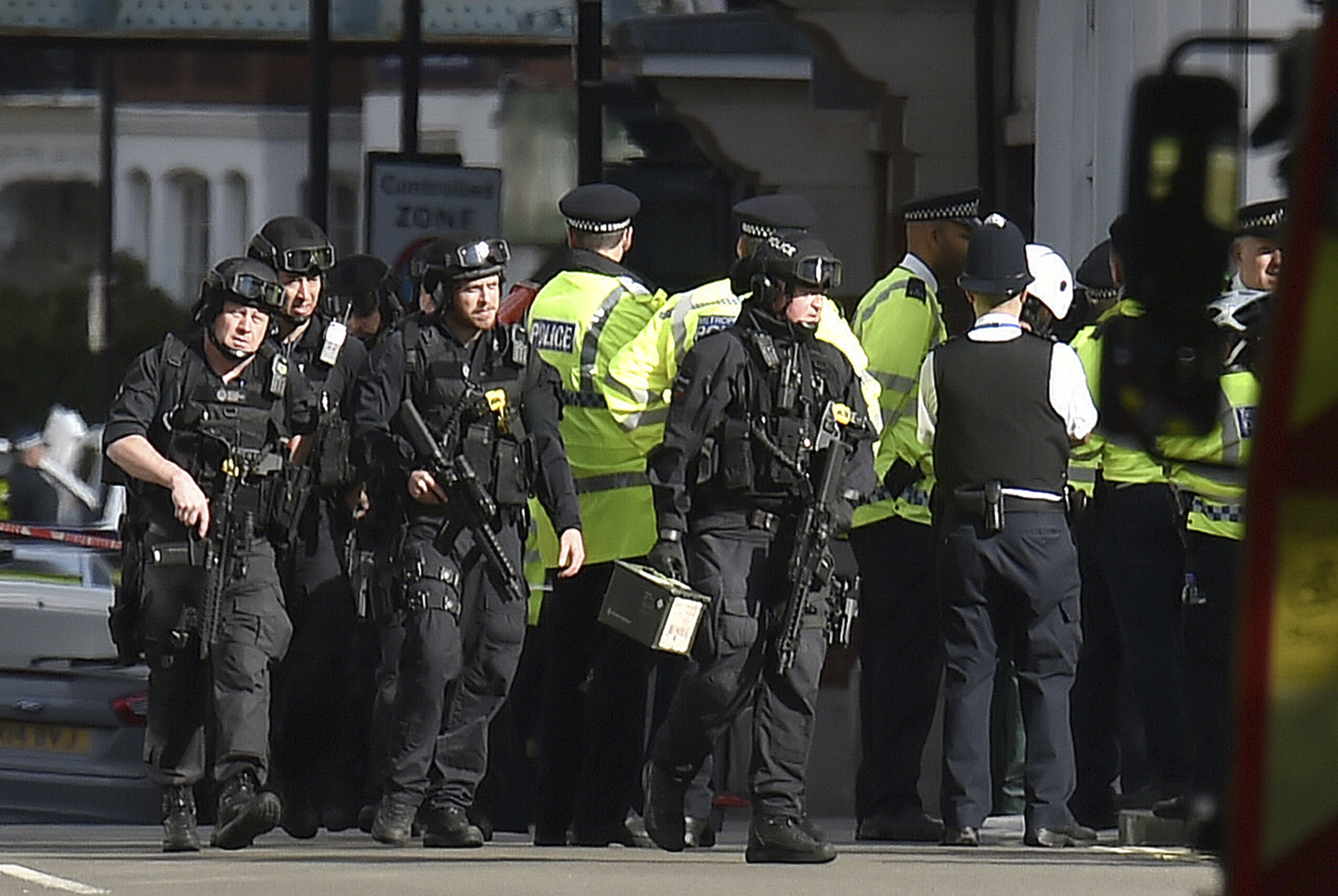 <div class='meta'><div class='origin-logo' data-origin='none'></div><span class='caption-text' data-credit='Dominic Lipinski/PA via AP'>Armed police close to Parsons Green station in west London after an explosion on a packed London Underground train, Friday, Sept. 15, 2017.</span></div>