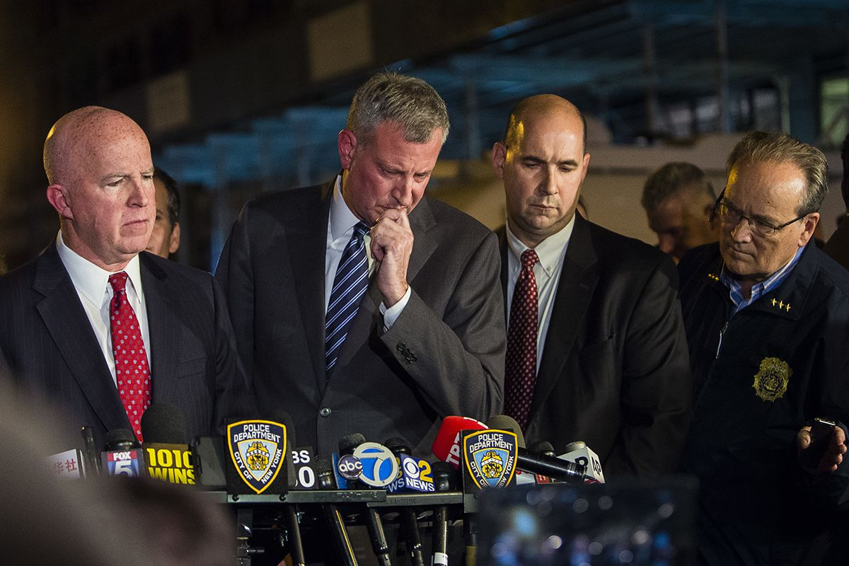 <div class='meta'><div class='origin-logo' data-origin='AP'></div><span class='caption-text' data-credit='AP Photo/Andres Kudacki'>Mayor Bill de Blasio, center, and NYPD Chief of Department James O'Neill, left, react during a press conference near the scene of an explosion on West 23rd street in Manhattan.</span></div>