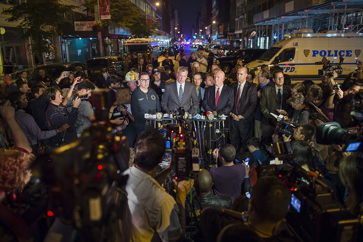 "<div class=""meta image-caption""><div class=""origin-logo origin-image ap""><span>AP</span></div><span class=""caption-text"">Mayor Bill de Blasio, center, and NYPD Chief of Department James O'Neill, center right, speak during a press conference near the scene of an apparent explosion on West 23rd Street. (AP Photo/Andres Kudacki)</span></div>"