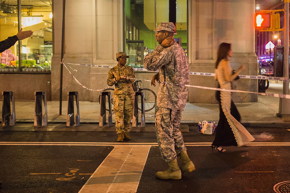 "<div class=""meta image-caption""><div class=""origin-logo origin-image ap""><span>AP</span></div><span class=""caption-text"">People try to access the area near the scene of an explosion on West 23rd Street and 6th Avenue as members of the military stand guard in Manhattan's Chelsea neighborhood. (AP Photo/Andres Kudacki)</span></div>"
