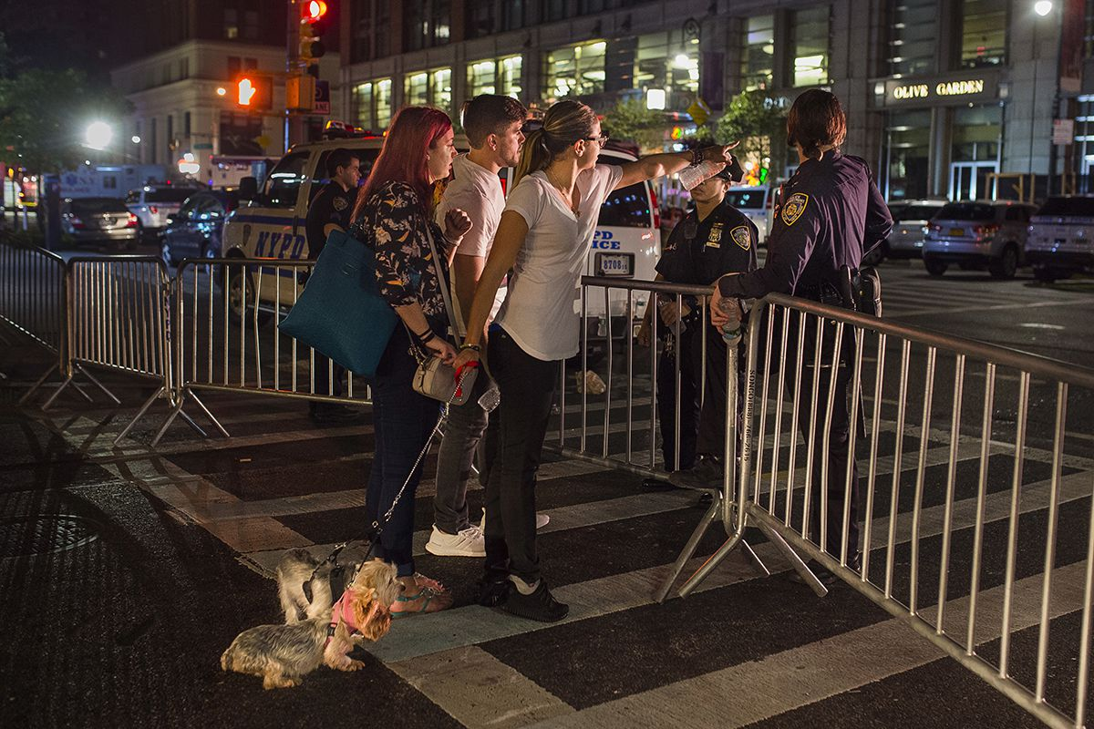 <div class='meta'><div class='origin-logo' data-origin='AP'></div><span class='caption-text' data-credit='AP Photo/Andres Kudacki'>People try to access the area near the scene of an explosion on West 23rd Street and 6th Avenue in Manhattan's Chelsea neighborhood, in New York, early Sunday, Sept. 18, 2016.</span></div>
