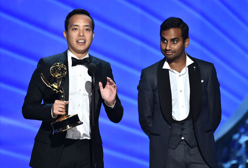 "<div class='meta'><div class='origin-logo' data-origin='AP'></div><span class='caption-text' data-credit='Photo by Vince Bucci/Invision for the Television Academy/AP Images'>Kelvin Yu, left, and Aziz Ansari accept the award for outstanding writing for a comedy series for ""Master of None"" at the 68th Primetime Emmy Awards on Sunday, Sept. 18, 2016.</span></div>"