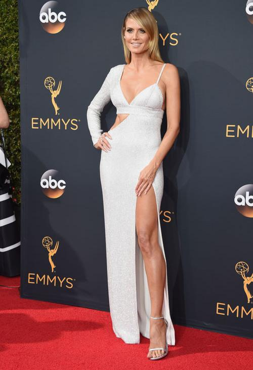 <div class='meta'><div class='origin-logo' data-origin='AP'></div><span class='caption-text' data-credit='Photo by Phil McCarten/Invision for the Television Academy/AP Images'>Heidi Klum arrives at the 68th Primetime Emmy Awards on Sunday, Sept. 18, 2016, at the Microsoft Theater in Los Angeles.</span></div>