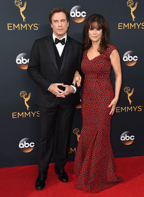 <div class='meta'><div class='origin-logo' data-origin='AP'></div><span class='caption-text' data-credit='Photo by Jordan Strauss/Invision/AP'>John Travolta, left, and Kelly Preston arrive at the 68th Primetime Emmy Awards on Sunday, Sept. 18, 2016, at the Microsoft Theater in Los Angeles.</span></div>